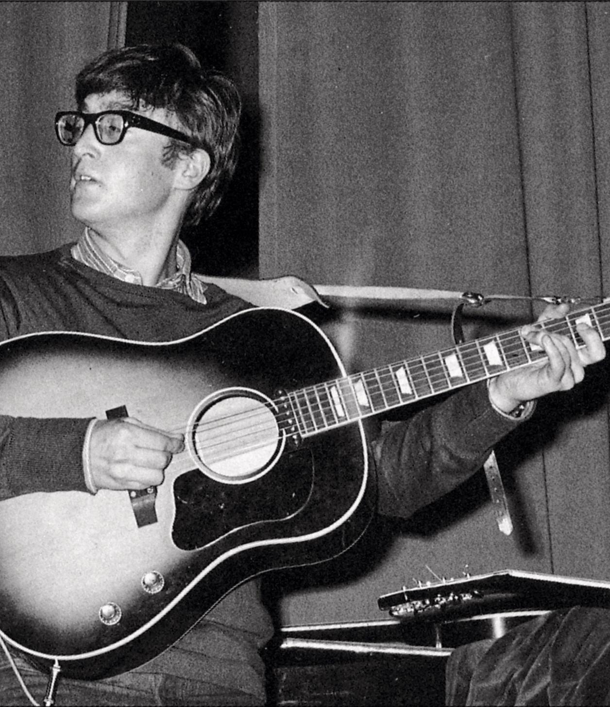 John Lennon with his 1962 Gibson J-160E and Selmer strap.