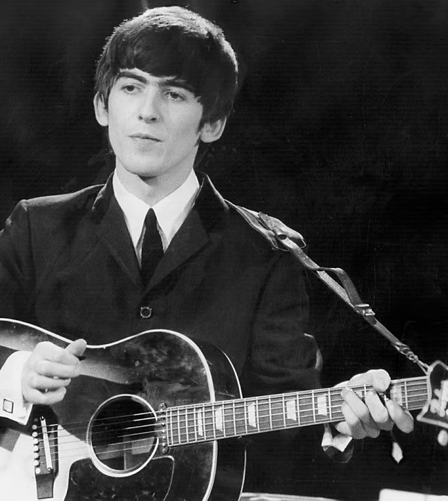 George Harrison with his J-160E and Selmer strap.