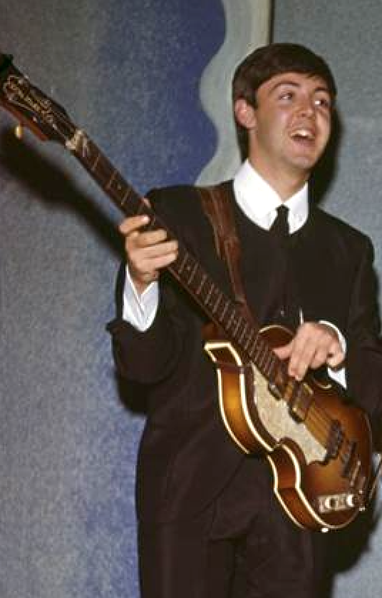 Paul McCartney with his 1961 Hofner bass and leather strap.