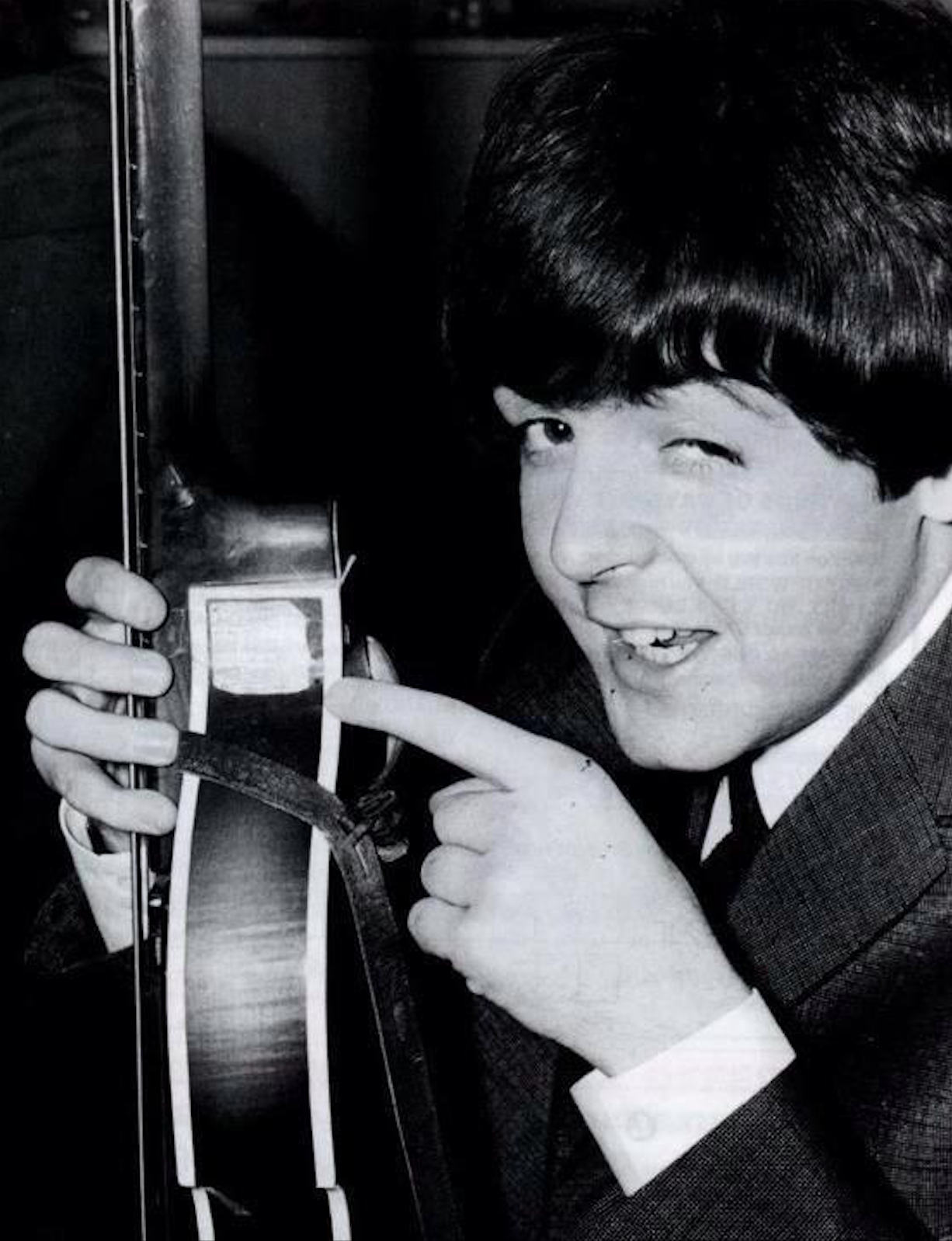 Paul McCartney with his 1963 Hofner bass and leather strap.