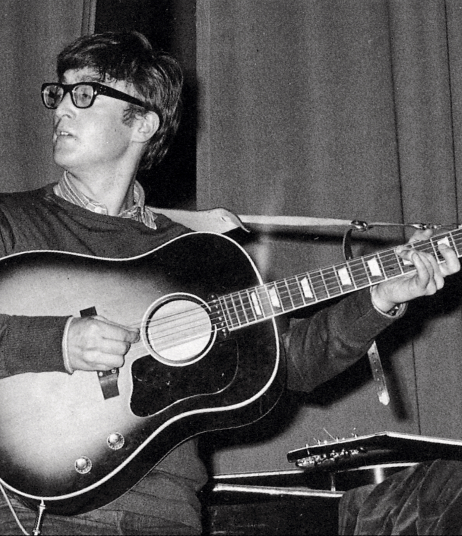 John Lennon with his Gibson J-160E and leather strap.