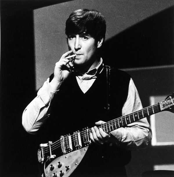 Lennon with Rickenbacker 325 and Selmer strap, 1963.