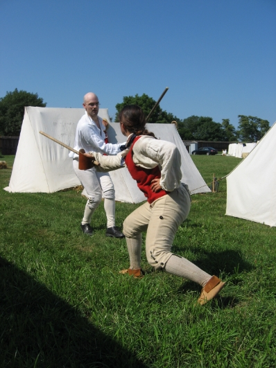 Enlightenment Classes -  Ian Brackley and Aurora Simmons  sparring with single stick at a Enlightenment reenactment at Fort George, ON.