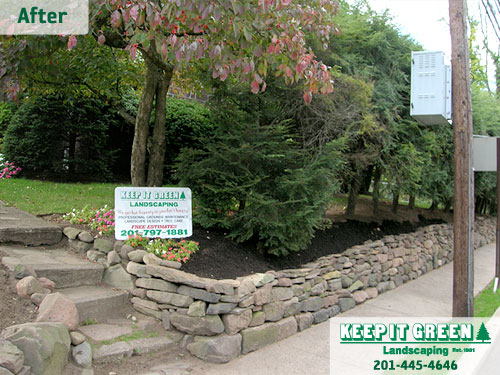 Natural stone wall rebuilt with existing stone . Glen Rock, NJ 07452