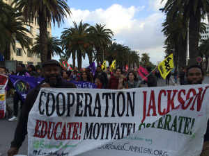 Kali and Adofo representing Cooperation Jackson at the 2015 World Social Forum march for Palestine in Tunis