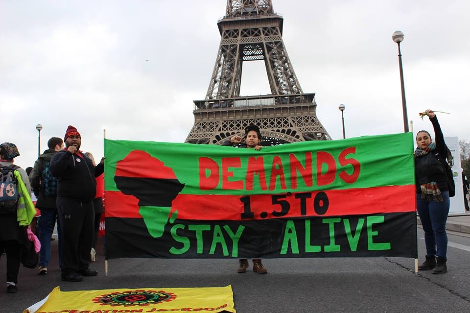 COOPERATION JACKSON MEMBERS IN PARIS AT THE REDLINES ACTION DEMANDING CLIMATE JUSTICE
