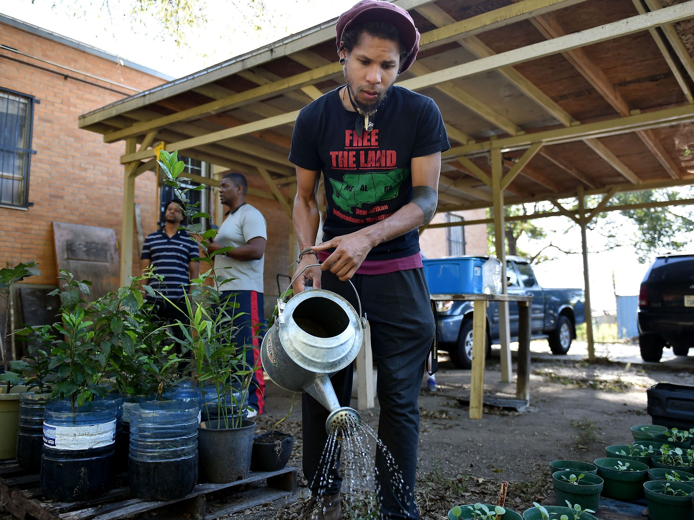 Jackson resident brandon king, who spells his name in all lowercase letters, waters the plants behind Cooperation Jackson on Oct. 4, 2017, in Jackson. (Photo Credit: Justin Sellers/Clarion Ledger)