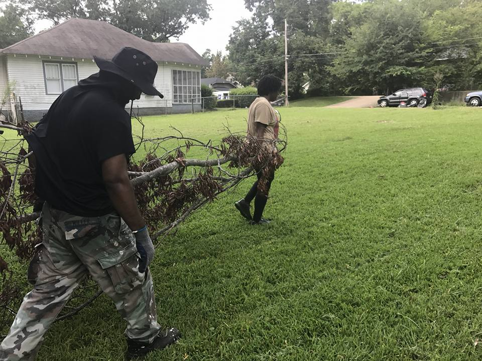 Cooperation Jackson members moving a branch at a kazi mob