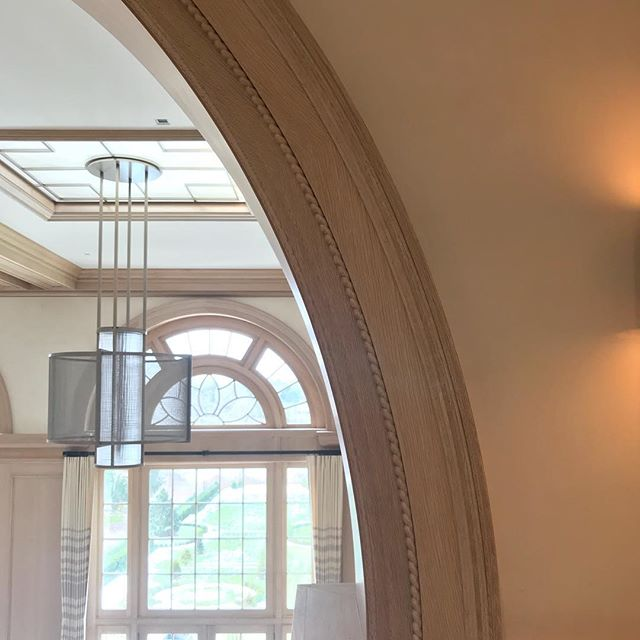 These spectacular architectural moldings were finished by hand with custom colored wax to achieve a uniform, soft, and natural tone. A one-of-a-kind finish in a one-of-a-kind home. ✨