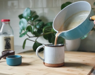 With a fine sieve, strain tea and spices and pour chai for yourself, and any guests.