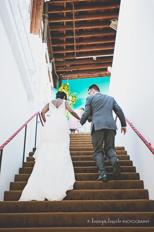 Anita and Mathias hurrying up our stairs as husband and wife to meet their friends and family, many who traveled all the way from India and Germany for the wedding.
