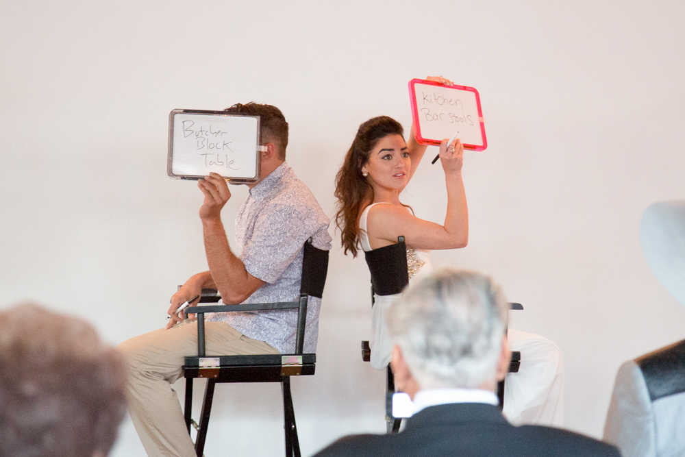 """The bride and groom-to-be, Chelsey and Joe getting a laugh out of their guests by playing the """"Newlywed Game."""" Chelsey took the cake by answering the most questions about her beloved right."""