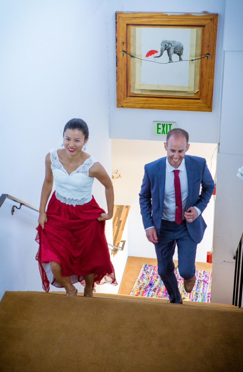 The happy couple scurrying up the stairs to celebrate.