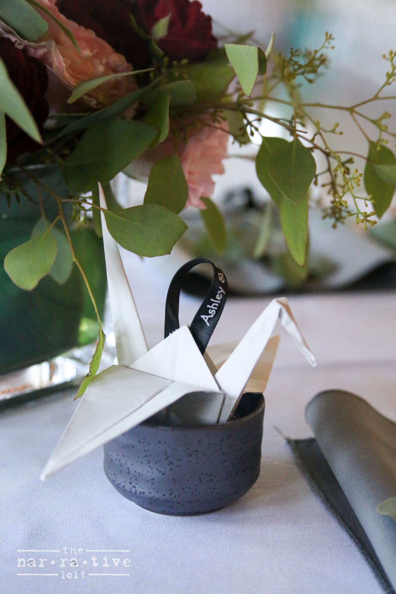Sake cups and origami cranes as wedding favors. We're in love!