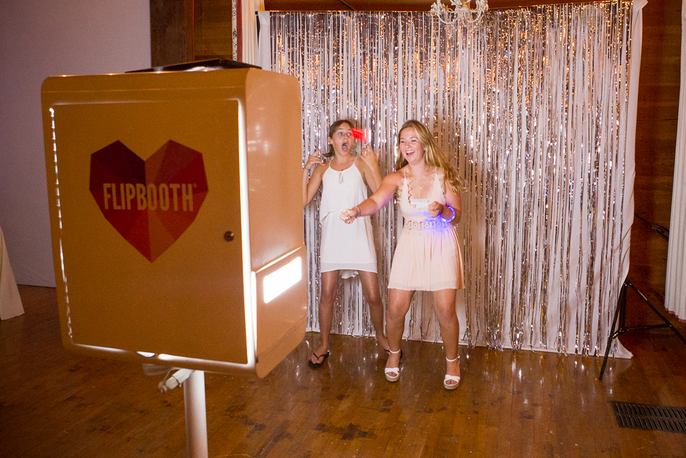 The star of the evening, Makena and her friend living it up in front of the photobooth!