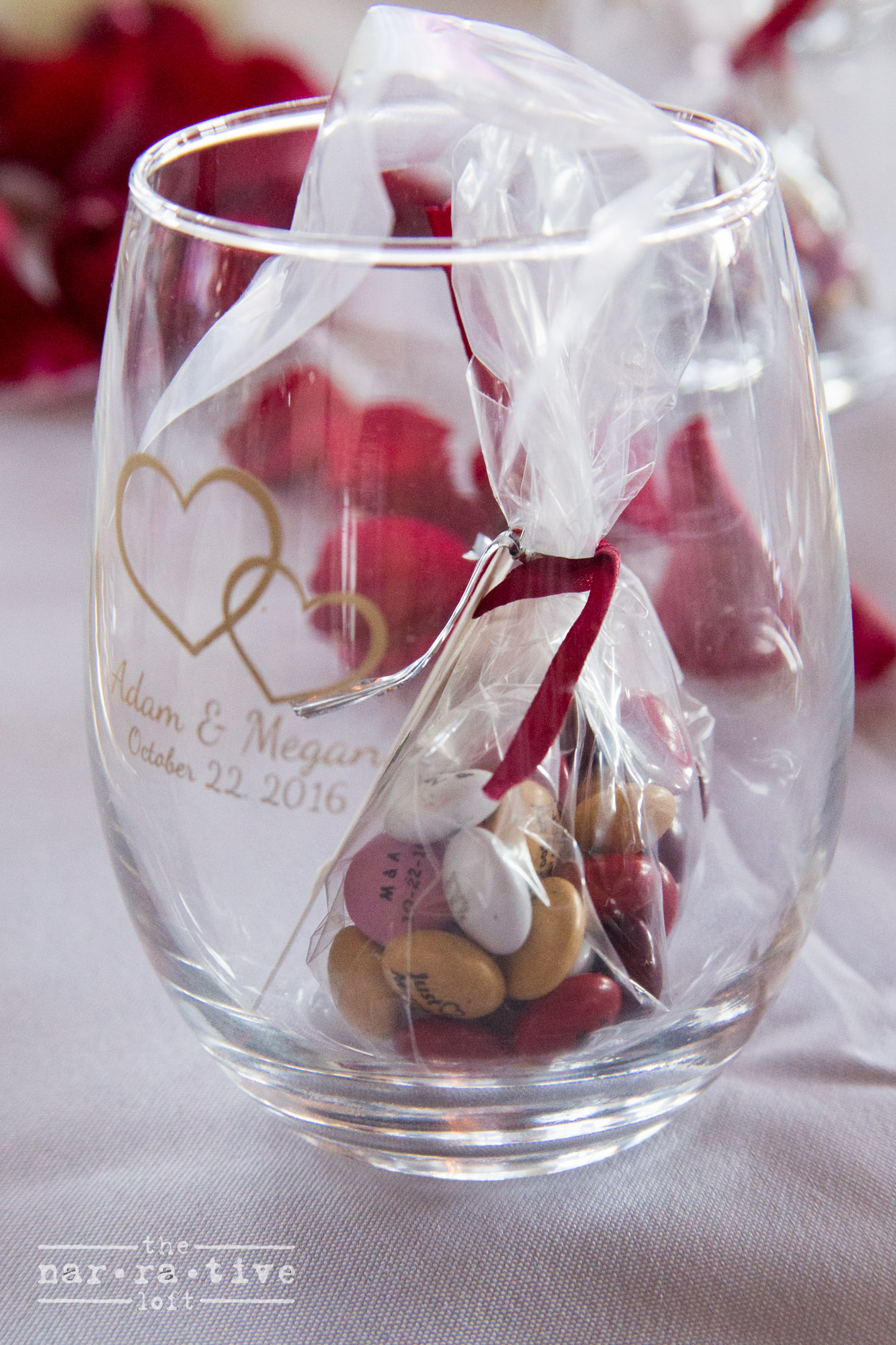 Personalized glasses plus M&M's were given to guests to remember the special day.