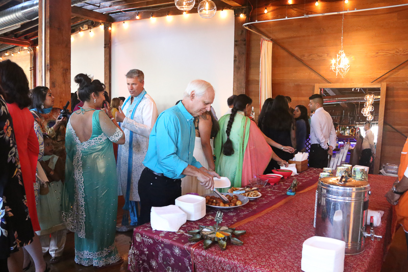 Guests enjoying the delicious spread from  Nimita's Cuisine !  Photo Credit: The Narrative Loft
