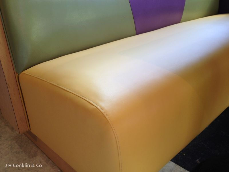 Restaurant booth seat covered in Nytek high performance material.