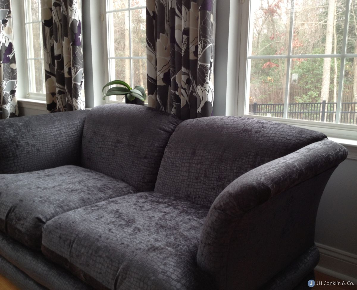 """Mullica Hill loveseat re-upholstered in an alligator pattern chenille by Fabricut. The variable nap of the fabric gives a """"crushed"""" look. The shimmery gray color is just right for the room."""