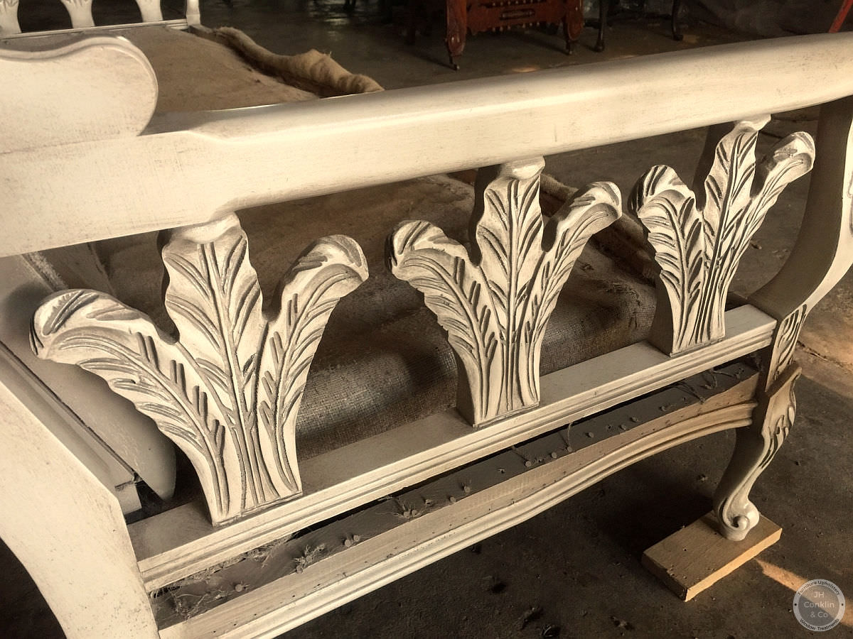 Sofa frame from the 1970's refinished with creamy white lacquer and a grey-brown glaze.
