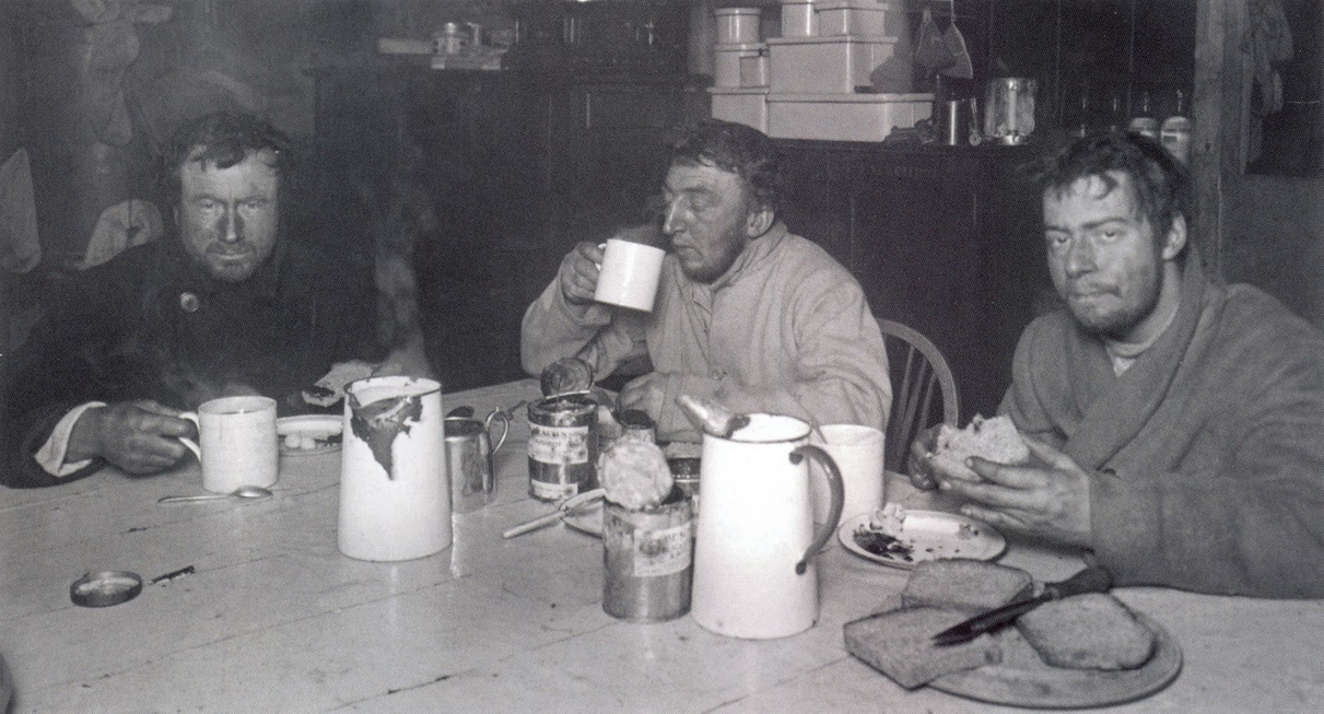 Wilson, Bowers and Cherry-Garrard tuck into a well-earned meal back at Cape Evans, having endured some of the worst conditions on Earth in the name of science.
