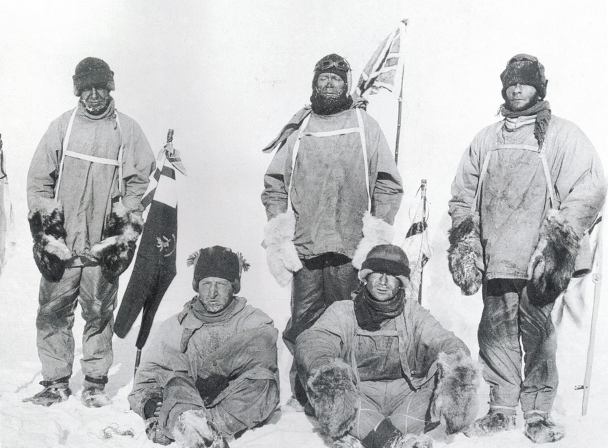 (from left, standing) Oates, Scott and Evans, with (sitting) Bowers and Wilson, display the British flag at the South Pole, a little over a month after Amundsen and his three companions had claimed it for Norway. The film was found at the Last Camp and developed later.