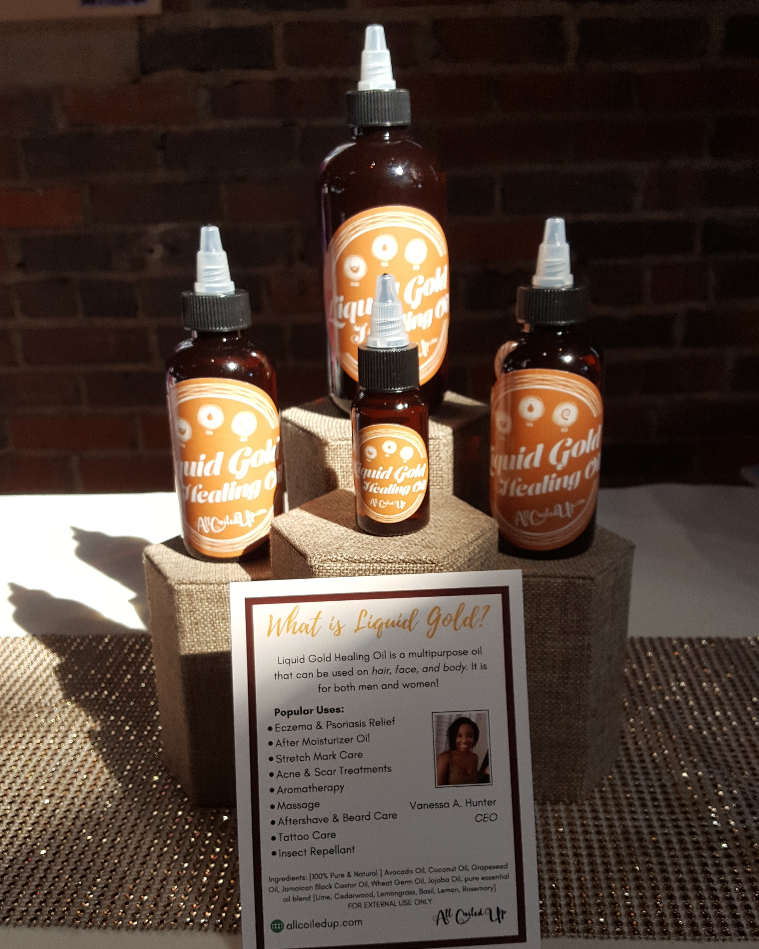 Bottles of Liquid Gold healing serum