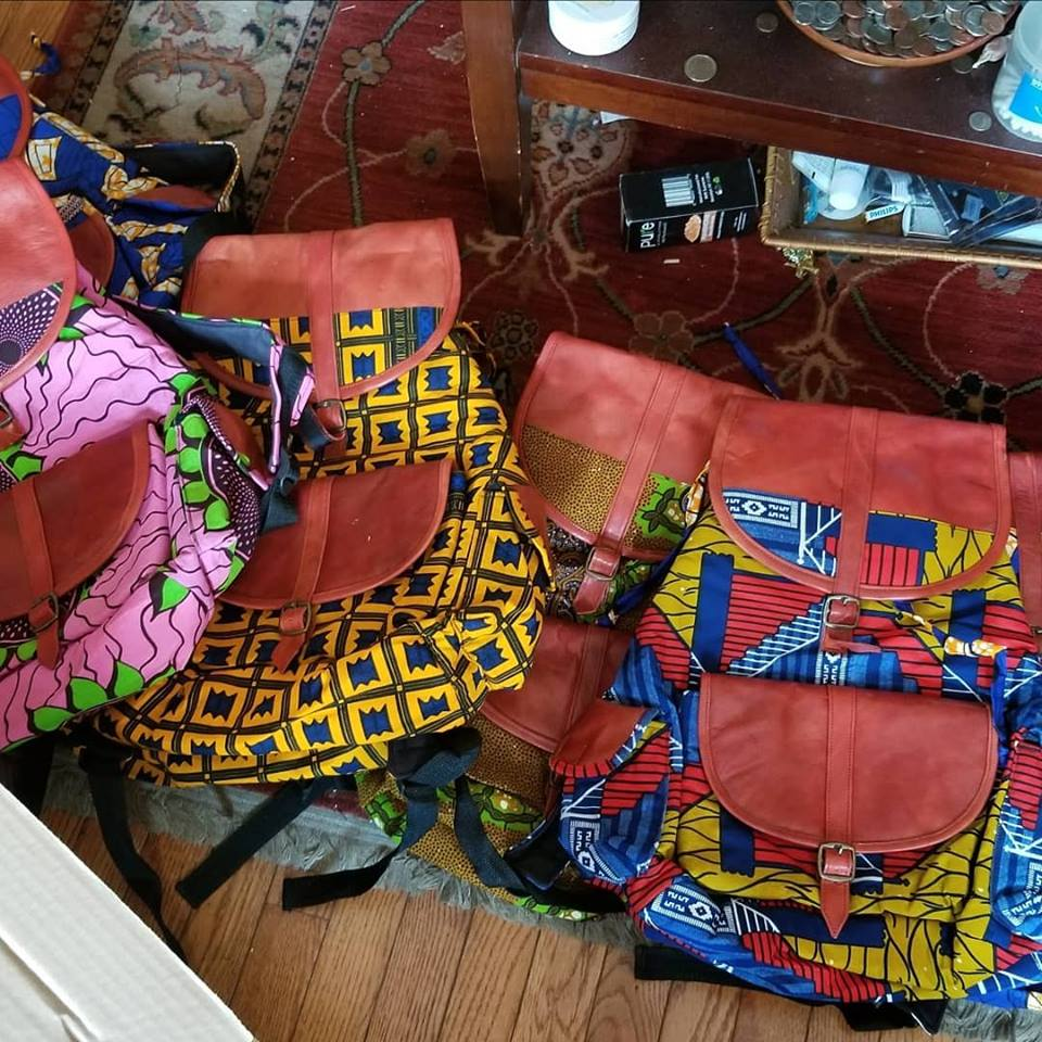 Pile of colorful African wax print purses