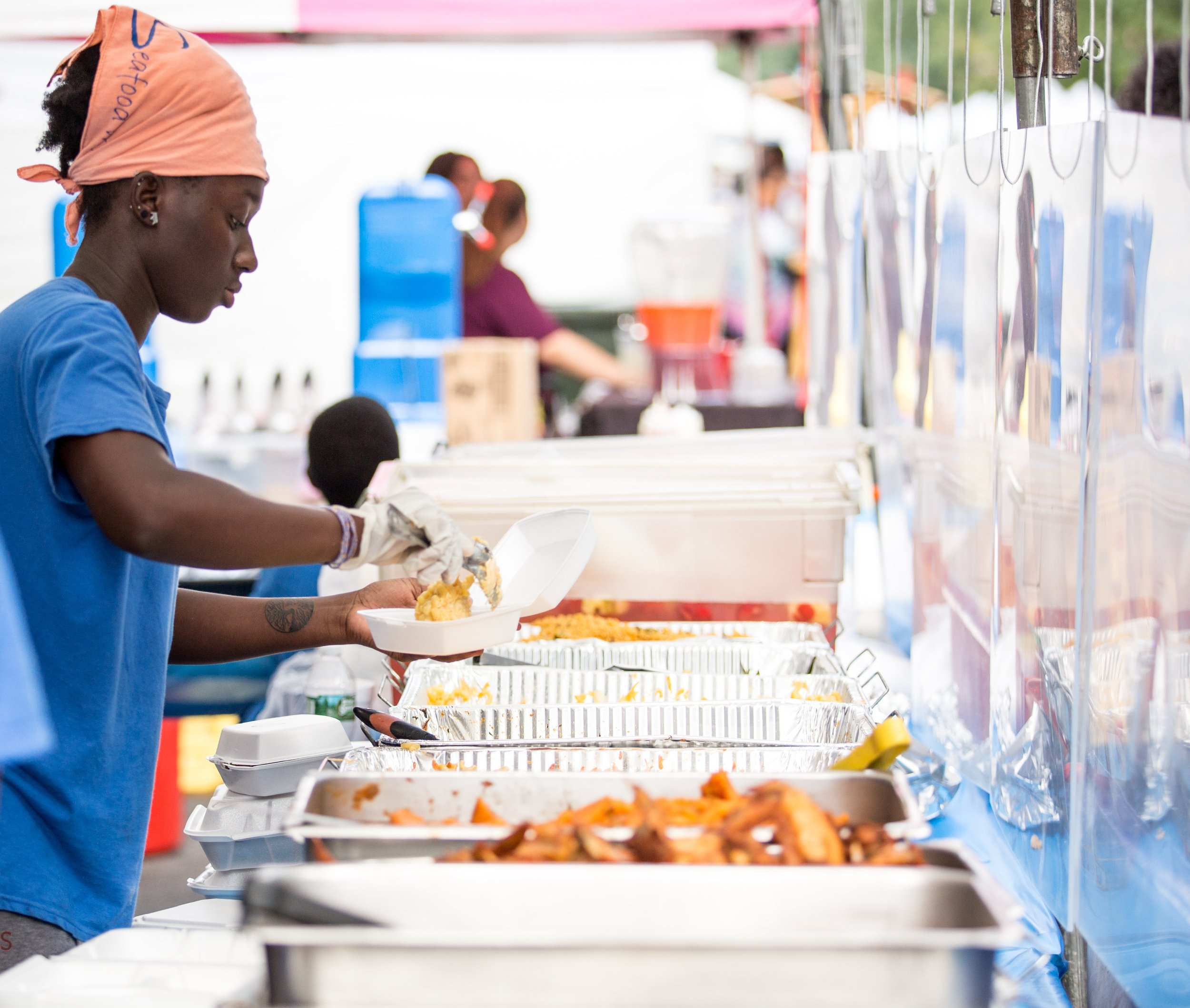Woman serving food at festival