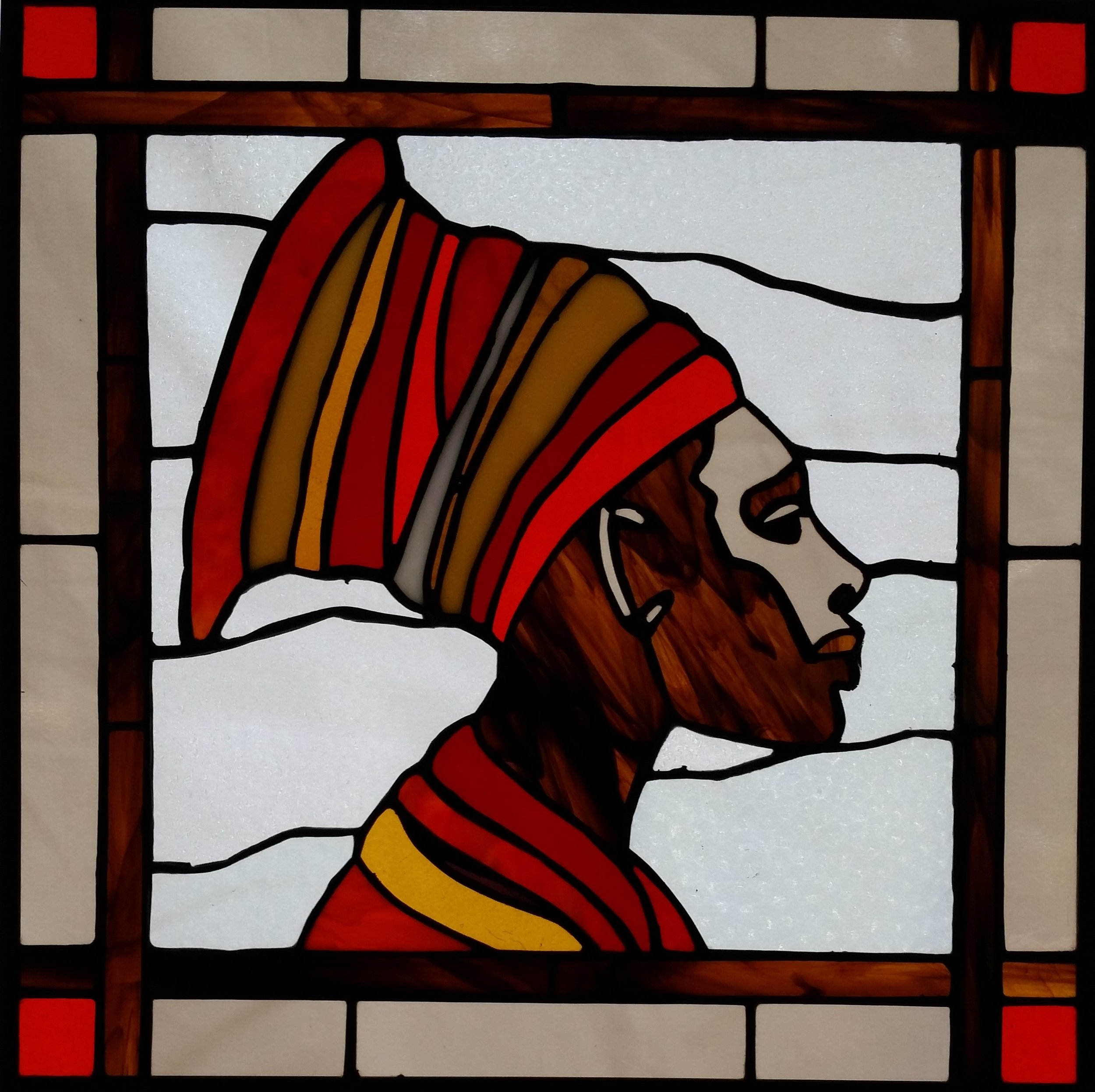 stained glass image of woman in headwrap by Arvid Lee