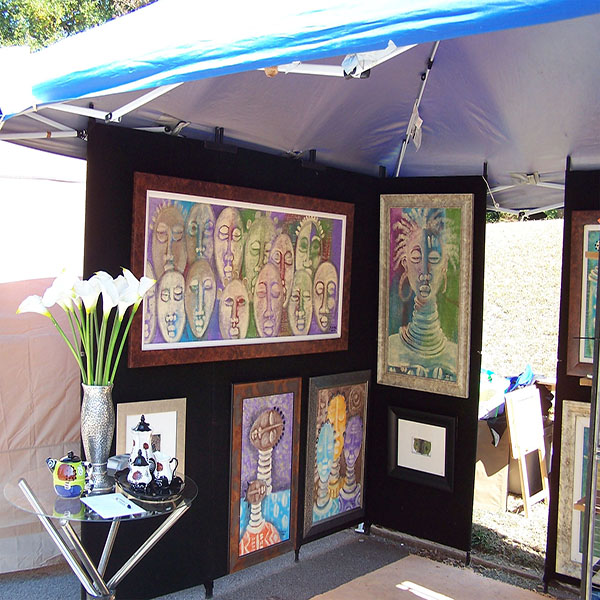 artist Joyce Lomax's booth showing paintings