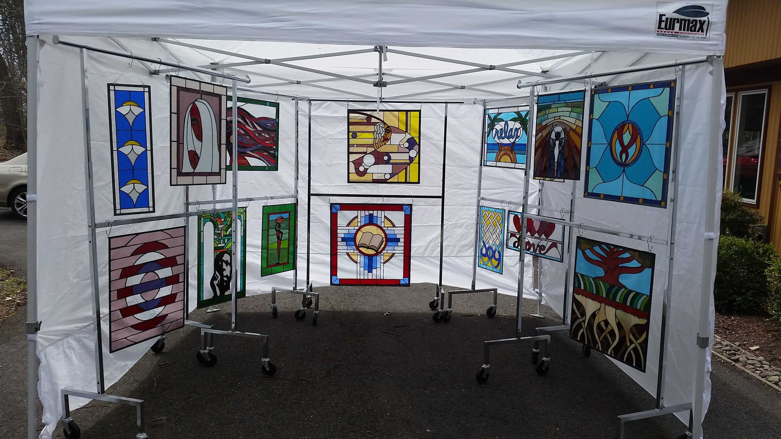 stained glass artist Arvid Lee's booth showing his work