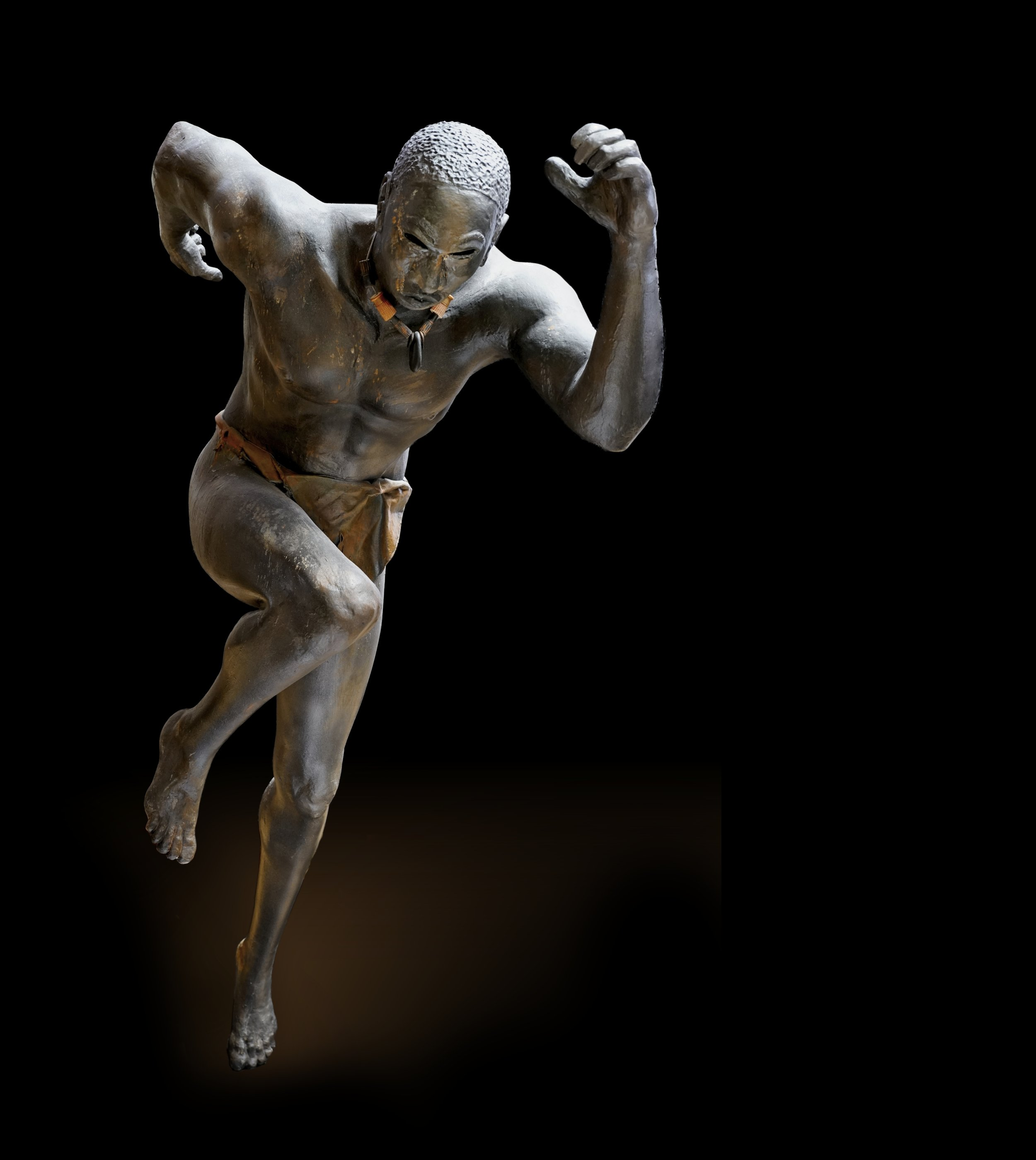 sculpture of African man running, by Aaron Paskins