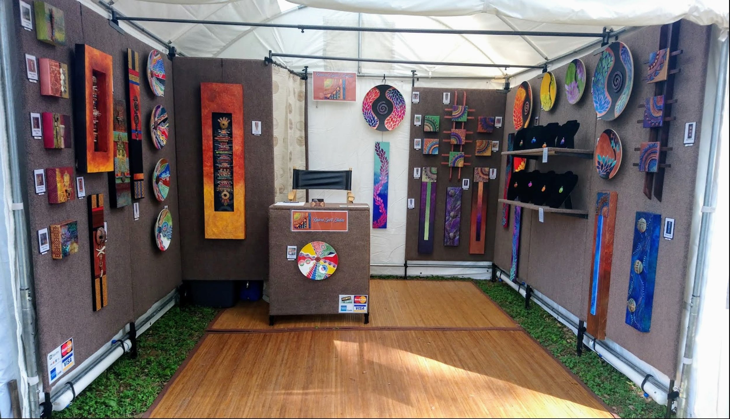 mixed media artist Michelle Davis Petelinz's booth, showing her wall art