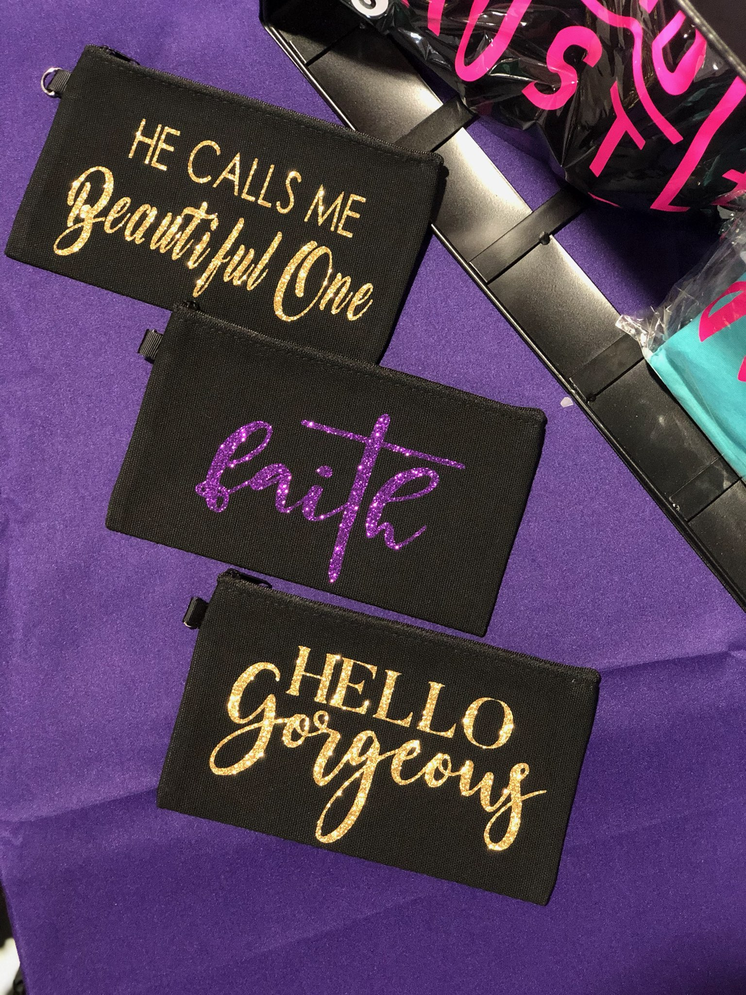 "Three small purses:  ""Beautiful One"", ""Faith,"" and ""Hello Gorgeous"""