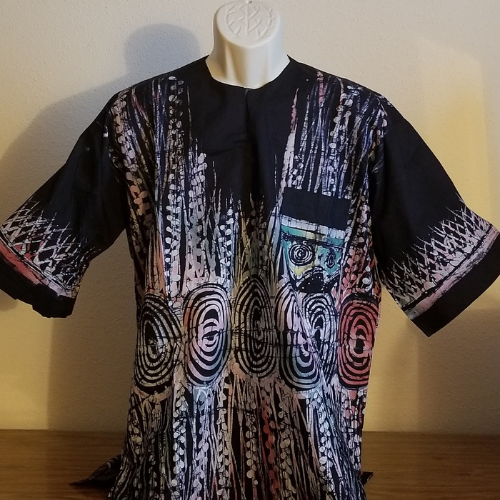 Man's black shirt printed with pastel designs
