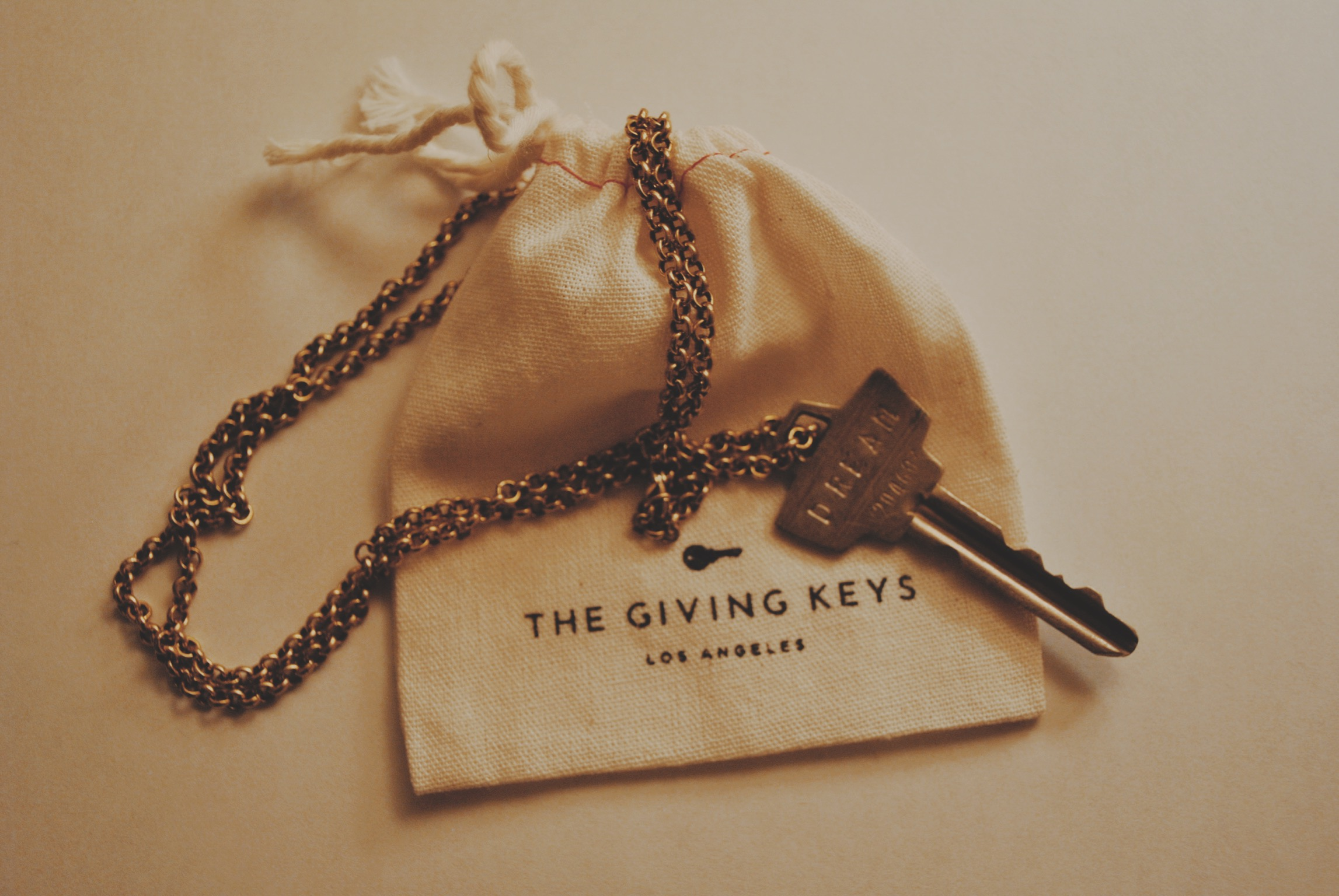 The Giving Key's employs individuals transitioning from homelessness to create inspiring jewellery from repurposed keys. Here is my purchased key with the  engraved  word Dream.