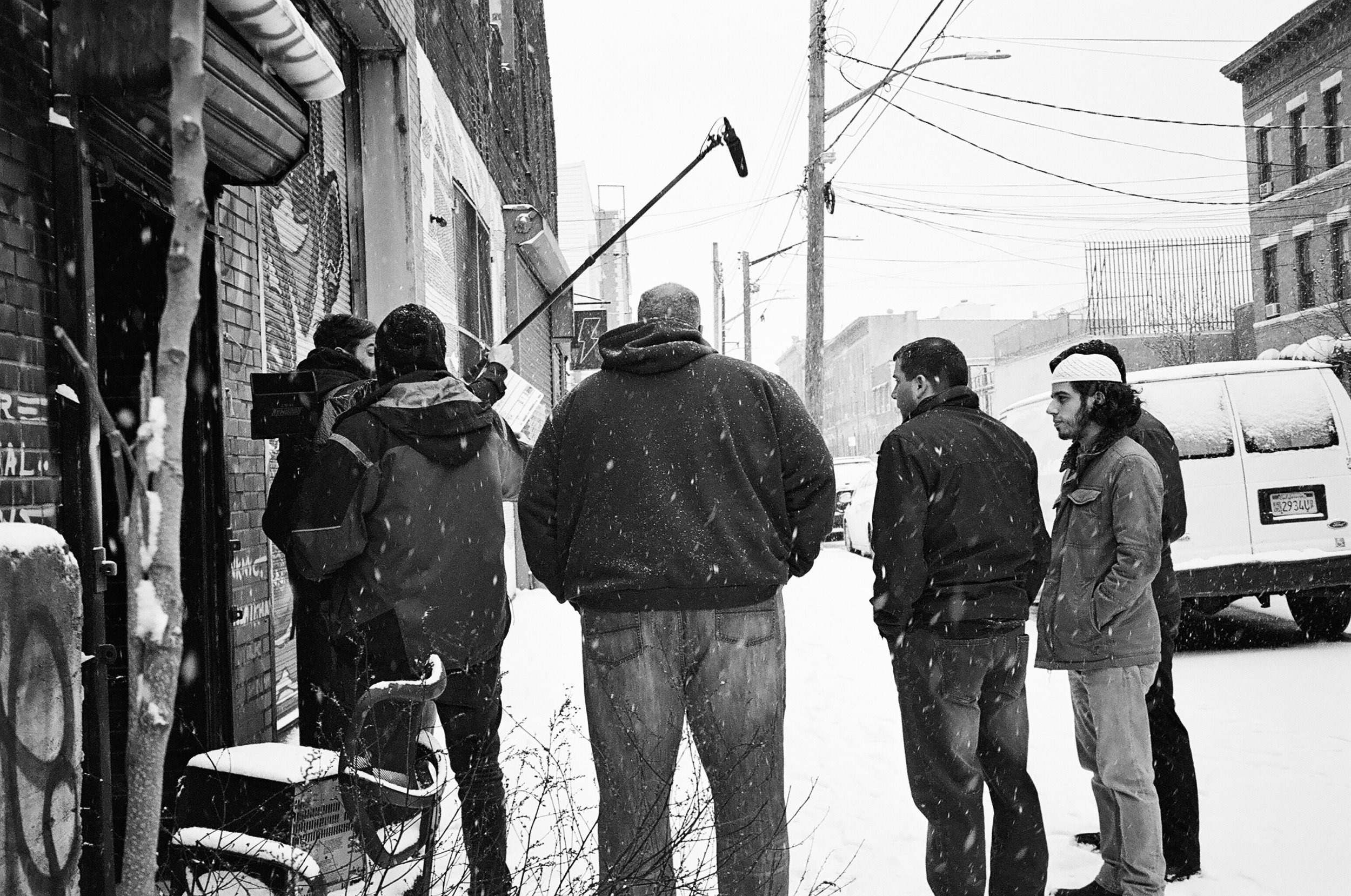 Kamal and his film crew setting up the shot in front of the studio.
