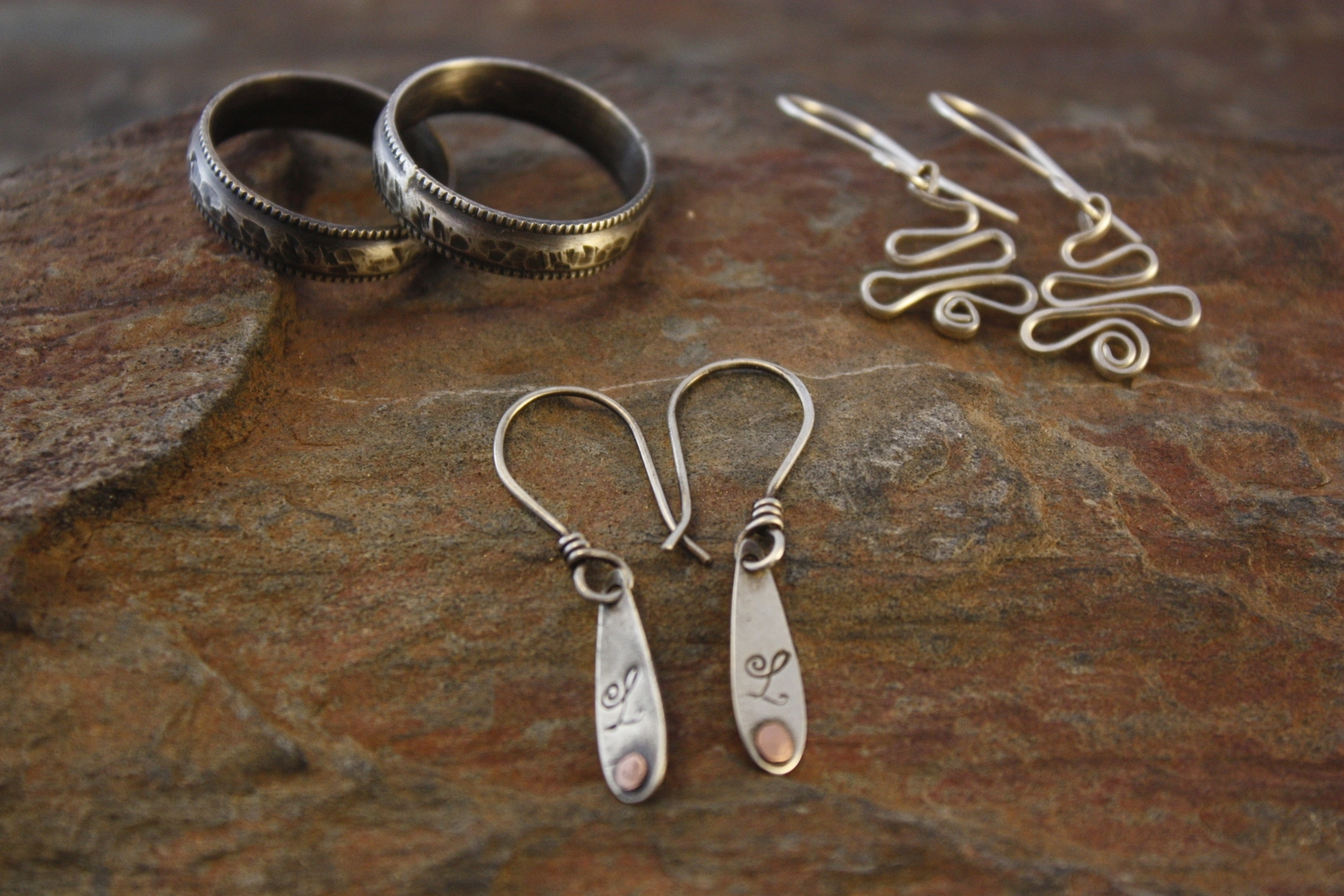Left to right, Excalibur(unisex ring), Lydia's Littles -Monogram Delights, Tree Delights.