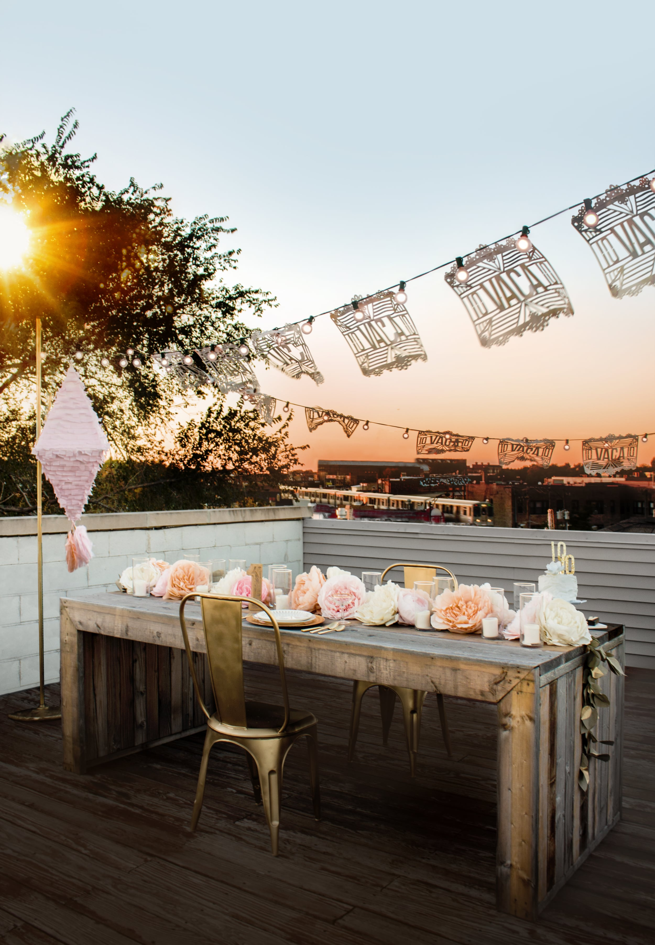 1st Anniversary Rooftop Dinner with Mexican Wedding Decor | Giant Paper Flower Garland Centerpiece and Gold Details | Sugar & Gold