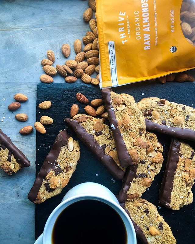 We're getting to that time where pesach is taking up most of our brain and the time has come to buy lots and lots of nuts. I've teamed up with @thrivemarket to bring you these epic almond chocolate chunk biscottis that are gluten free and kosher for P! Thrive market has a bunch of items that are approved by the @oukosher for Passover without special certification like nuts, baking soda and olive oil. They are organic, with great prices and delivered to your door!  For those of you who have been patiently waiting for this recipe, bless you! And here it is!!! These are actually so good that my mother in law has hidden the couple I brought to taste in the freezer so the rest of the family doesn't steal it 🙈 Oops! Sorry for revealing the spot! Feel free to replace the fillings (chocolate, almonds, and marzipan) with your favorite fillings!  3.5 c gluten free Flour blend (see previous post) 1/2 c Sugar  1 tsp @thrivemarket Baking soda 1/4 c @thrivemarket olive oil  1 tsp Cinnamon  Pinch Salt  1/2 c @thrivemarket Almonds chopped  2 Eggs 1 tsp Vanilla  1/2 tsp Almond extract  1 cup chocolate chunks 1/2 c Marzipan, diced and tossed with 2 tbsp flour blend (optional)  I used @busyinbrooklyn recipe 1 cup chocolate, melted (optional)  Preheat oven to 350F Mix the flour, sugar, baking soda, cinnamon and salt together in a large bowl In another bowl mix the extracts, oil, and eggs. Pour into the dry ingredients and mix until just combined  Fold in the chocolate, almonds, and marzipan if using.  Shape into 2 7x3 loaves with wet hands and place on a baking sheet lined with parchment. Bake for 25 minutes until golden.  Allow to cool completely (legit so it doesn't crumble!) before slicing diagonally and baking cut side up in a single layer at 300F for 20 minutes or until crisp but not burnt.  Dip into melted chocolate if desired  Eat lots!  #sponsored, #ThinkingThrive #glutenfree #dessert #passover #passoverrecipes