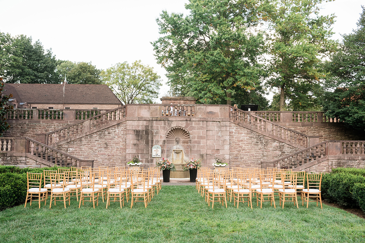 The Ceremony Lawn at Tyler Gardens is straight out of a movie. Ceremony florals by Julie D'Agostino Designs