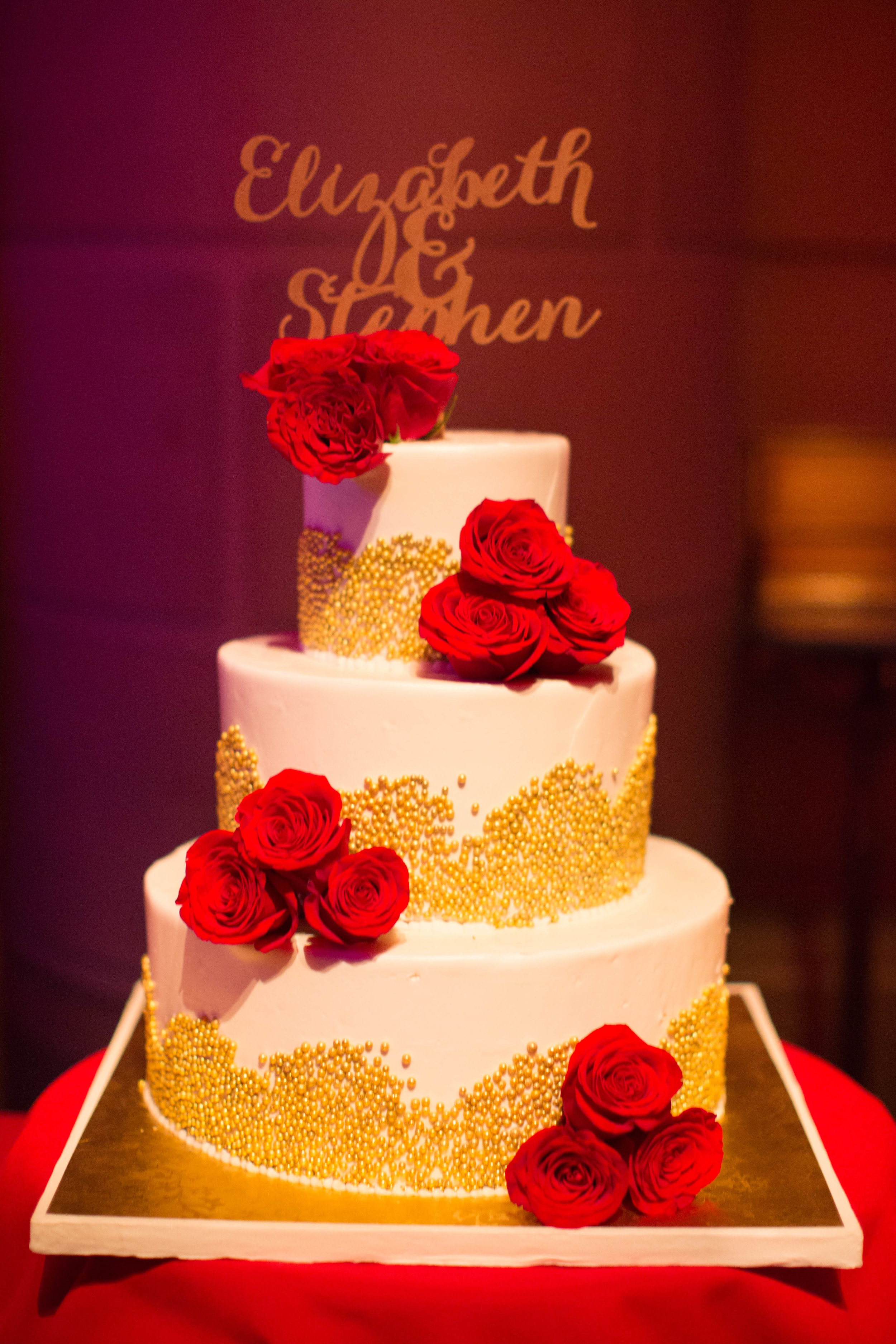 gold and red wedding cake.JPG