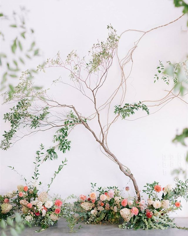 """@flwr_studio designed this photo booth wall to fit seamlessly into the space as a special floral """"moment"""" 📷 @echoesandwildhearts . . #floralinspiration #underthefloralspell #tomandjohna #nycwedding"""
