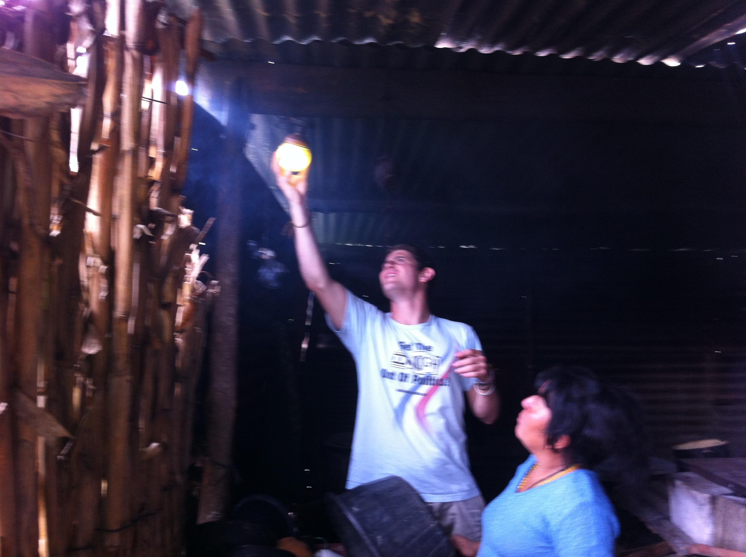 Alex providing solar energy units in rural Guatemalan villages.