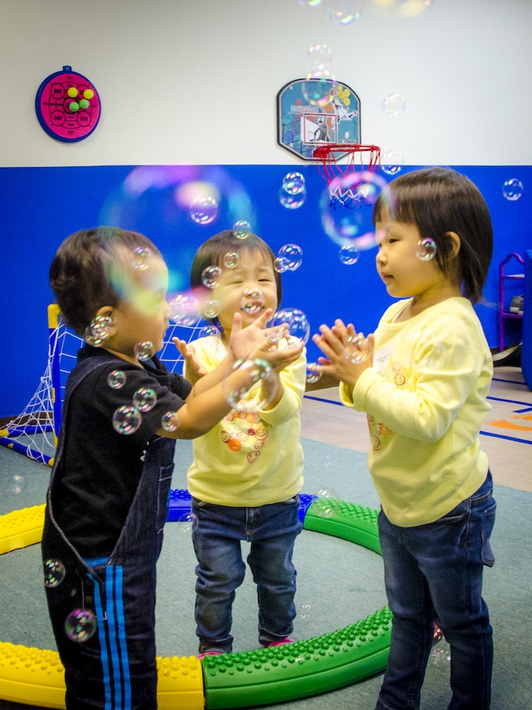 Catching bubbles at Imagination Land!