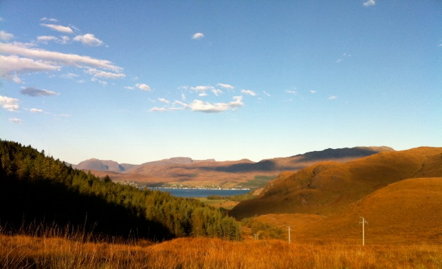 A View down the glen towards the cottages and Loch Carron beyond