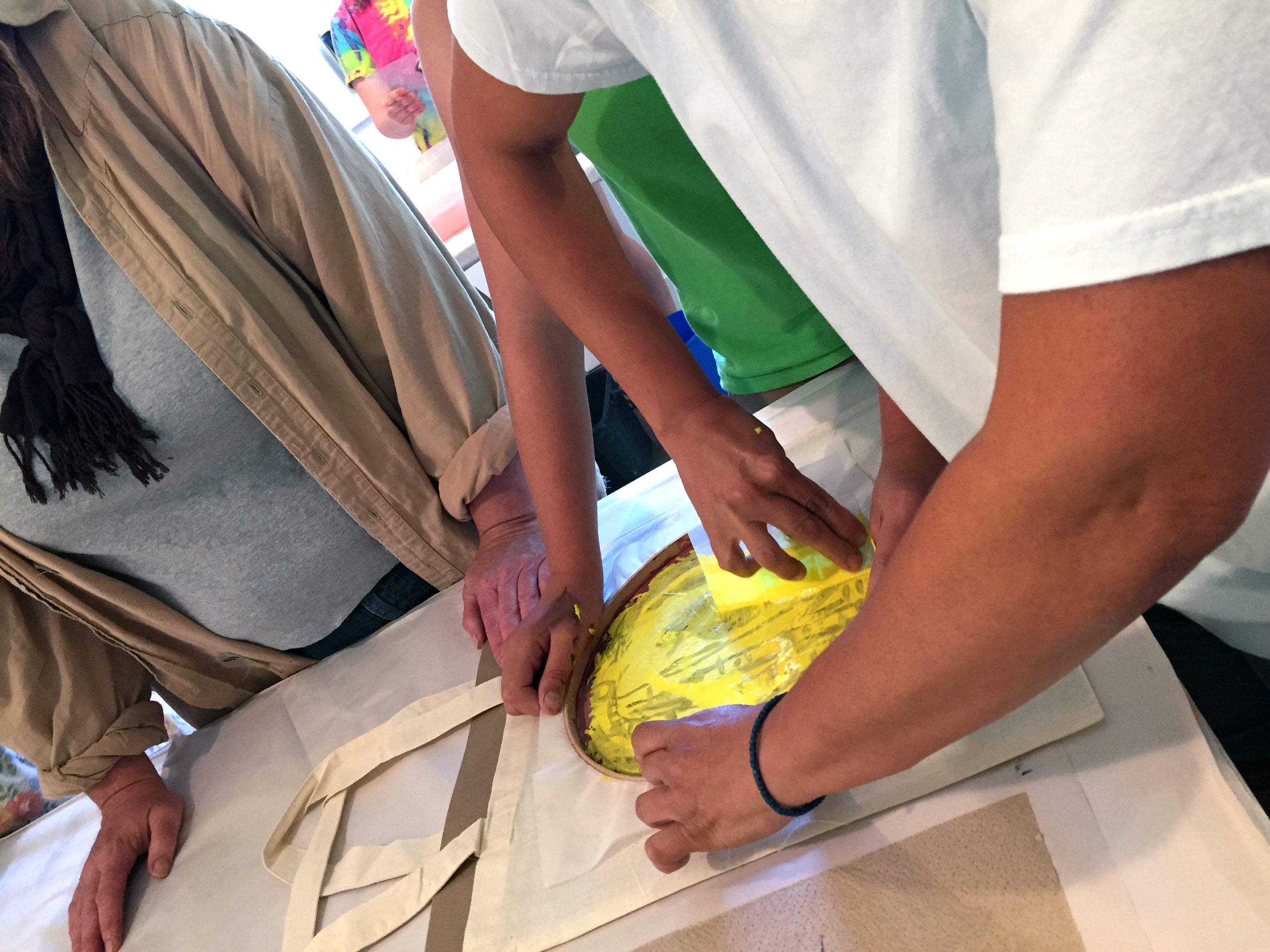 Some great teamwork taking place with Arista's DIY silkscreening
