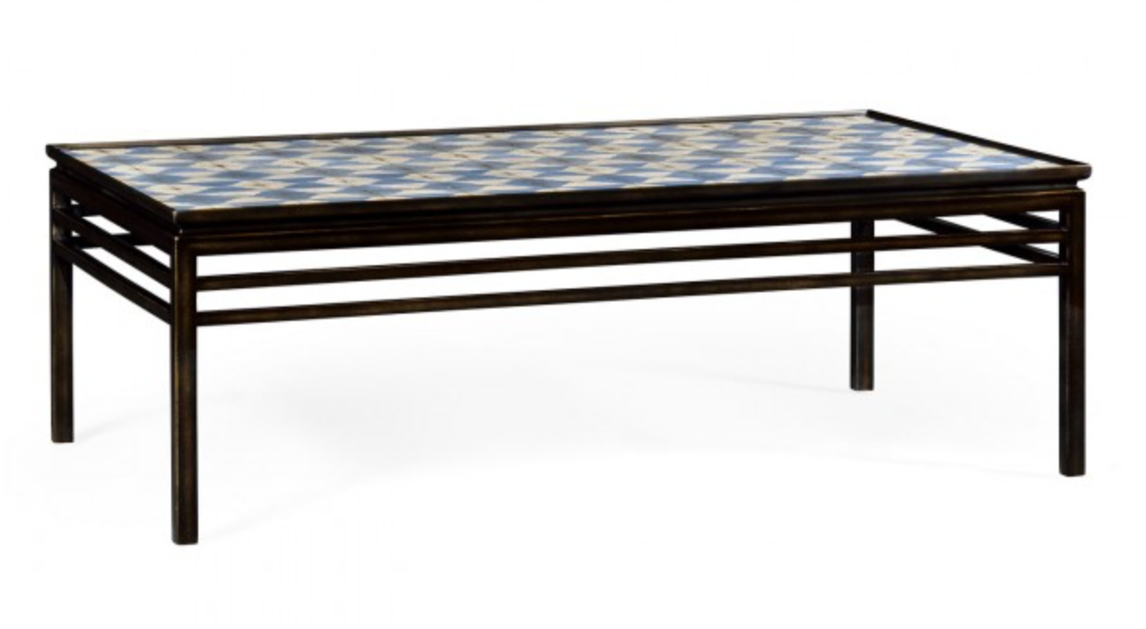 - White and blue marquetry coffee table sits so well in its bronzed frame. The base for the design on the top was stimulated by a visit to the museums of Seville.