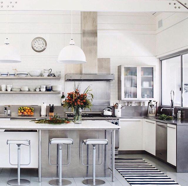 A neutral kitchen featuring an @AnnieSelke #DashAndAlbert Catamaran Stripe rug for a surprising pop of print!